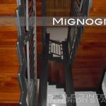 scala in acciaio e legno, vista intradosso , detail cosciali lamiera nera 100/10 pantografata e ringhiera con corrimano in legno