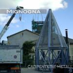 restauro della torre campanaria con nuova guglia in acciaio zincato, la struttura metallica assemblata a terra