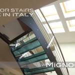 scala in acciaio cosciali in lemiera nera, gradini in vetro con inserti in seta, vista intradosso