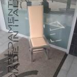 seduta in alluminio e pantografato. rivestimento in pelle di cammello . progetto architetto Mignogna