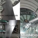 scala in acciaio e vetro. detail attacco dei gradini all'elica portante
