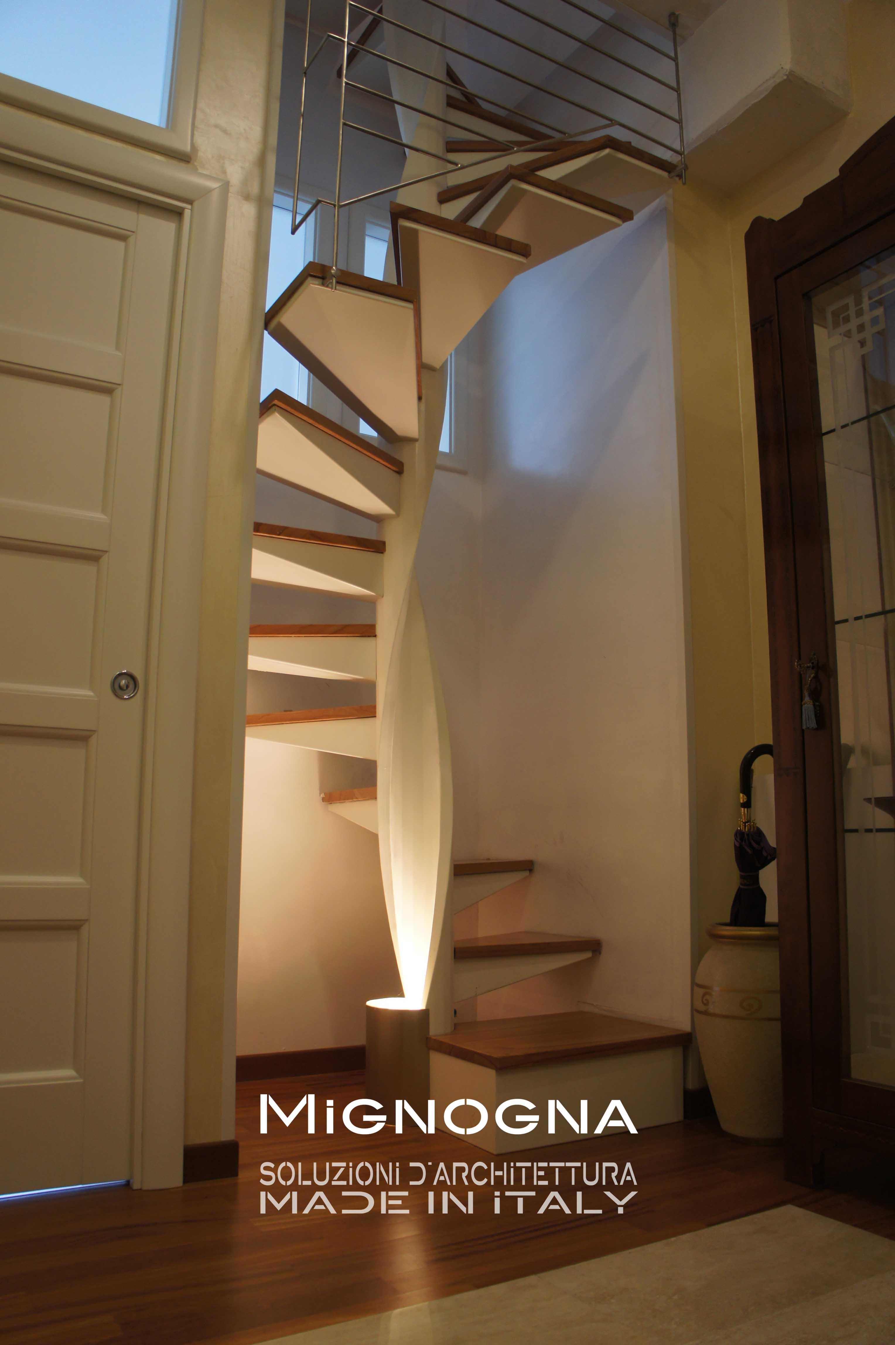 scala romantica in acciaio sagomato verniciato, gradini in legno, finiture inox . light design